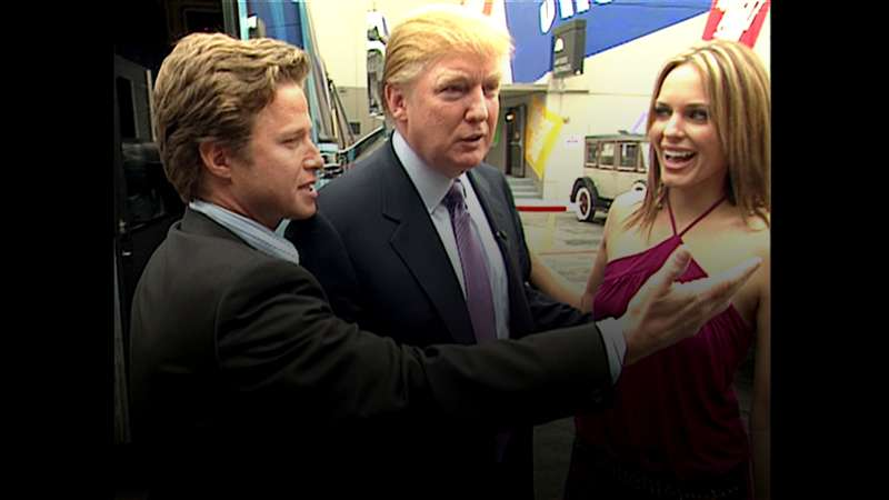 In this 2005 frame from video, Donald Trump (center)prepares for an appearance on 'Days of Our Lives' with actress Arianne Zucker (right). He is accompanied to the set by Access Hollywood host Billy Bush (left).