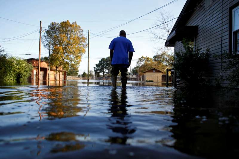 Eric McClary of West Mulberry Lane checks flood levels while checking on his flooded home after the effects of Hurricane Matthew in Goldsboro, North Carolina, October 12, 2016.