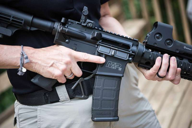 In this photo taken June 23, 2016, a Smith & Wesson M&P15 is held in Auburn, Georgia.