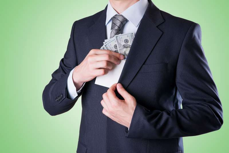 pulling money out of suit pocket