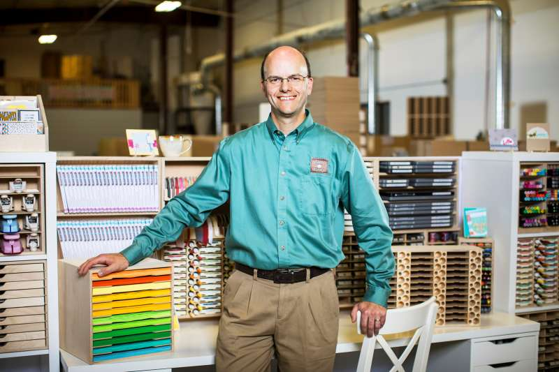Brett Haugen stands with his craft storage products at Stamp-n-Storage in Hutchinson, Minn., on Sunday, Sept. 18, 2016.                               Photo by Ackerman + Gruber               @ackermangruber