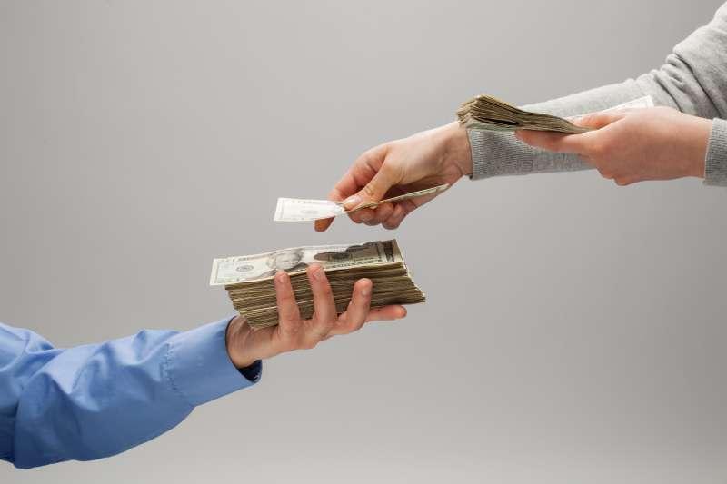 Woman handing man money