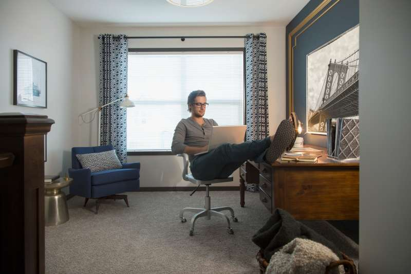 Man using laptop in home office