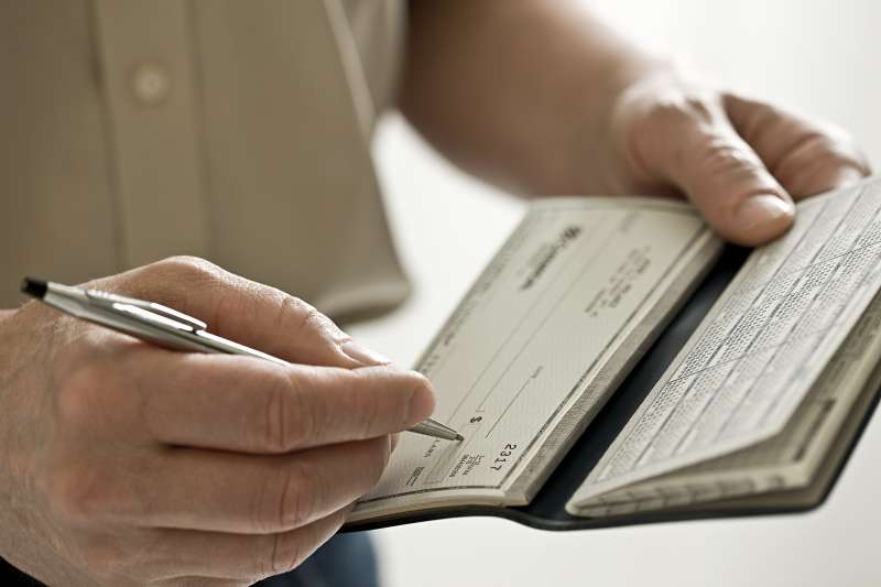 A man holding a cheque book