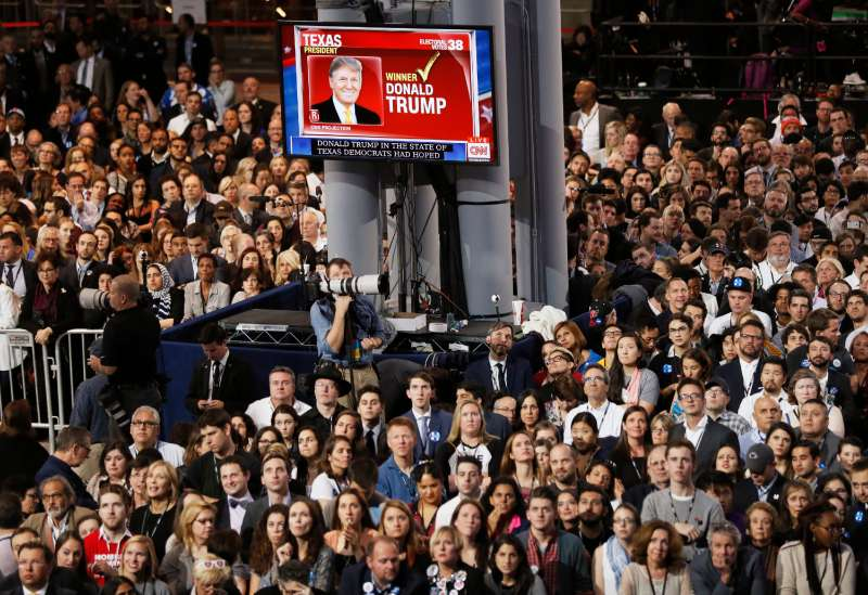 Supporters of Democratic U.S. presidential nominee Hillary Clinton watch election returns showing Donald Trump winning in Texas at the election night rally in New York on Nov. 8, 2016.