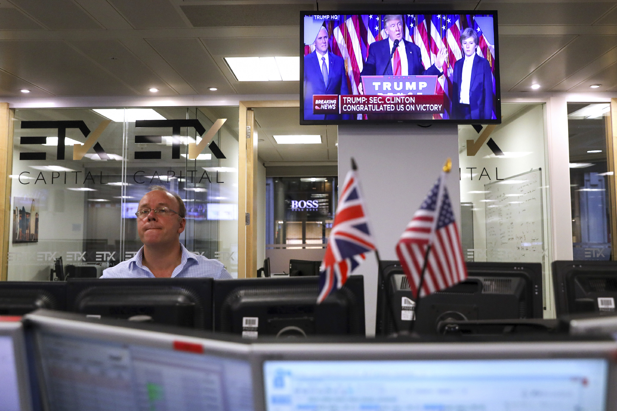 Traders on the floor at ETX Capital in London watched as Trump was elected. The UK markets suffered huge losses in June, after their own surprise Brexit referendum results sent stocks into a tailspin.
