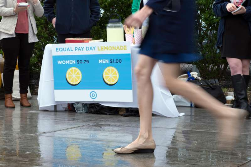 Democratic National Committee (DNC) women host an Equal Pay Day event with a lemonade stand   where women pay 79 cents per cup and men pay $1 per cup, to highlight the wage gap  on April 12, 2016 in Washington, DC.