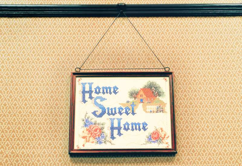 Home Sweet Home Painting Hanging on a Wall