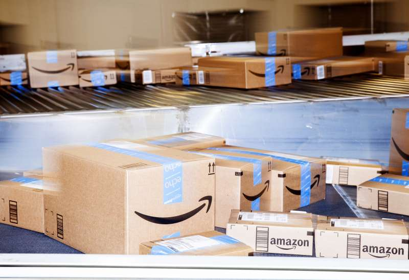 Boxes move along a conveyor belt inside an Amazon.com Inc. fulfillment center