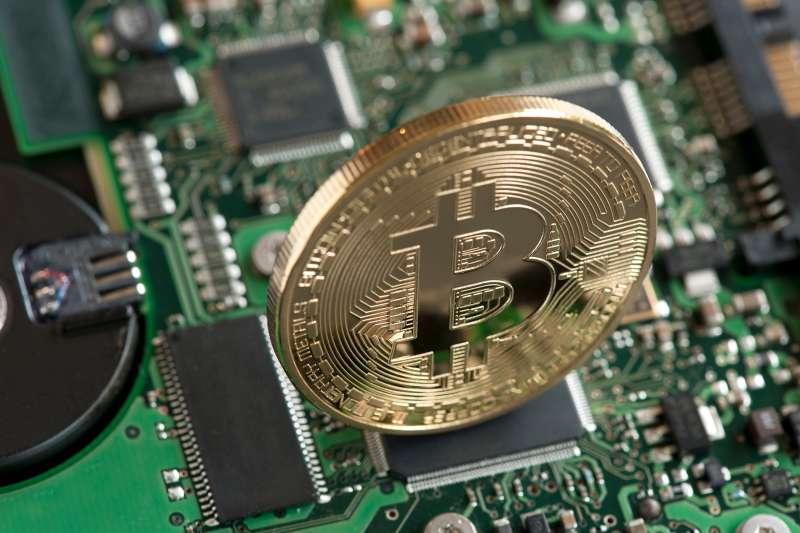 Bitcoin on circuit board.