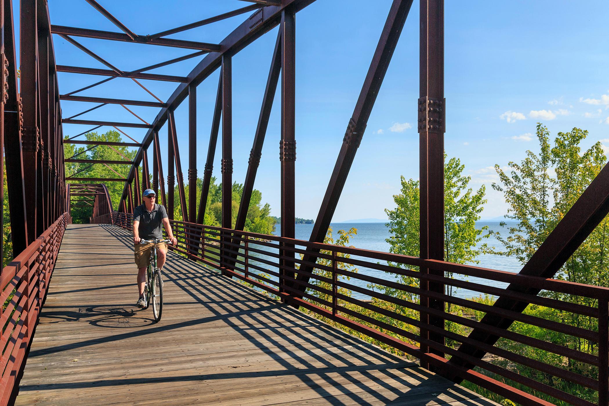 Man biking on the Burlington Bike Path by Lake Champlain