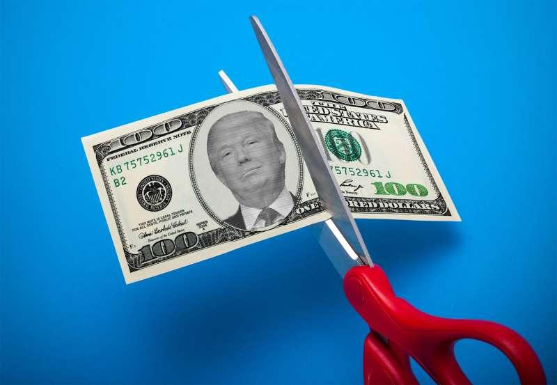 Trump on 100 dollar bill being cut in half