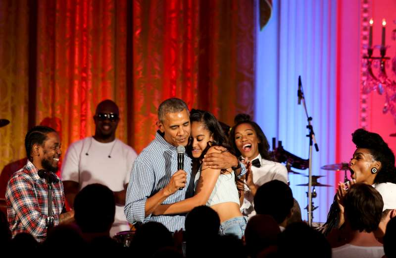 President Barack Obama hugs his daughter Malia Obama on her birthday, celebrated on July 4, 2016. The holiday party featured artists including Janelle Monae and Kendrick Lamar.