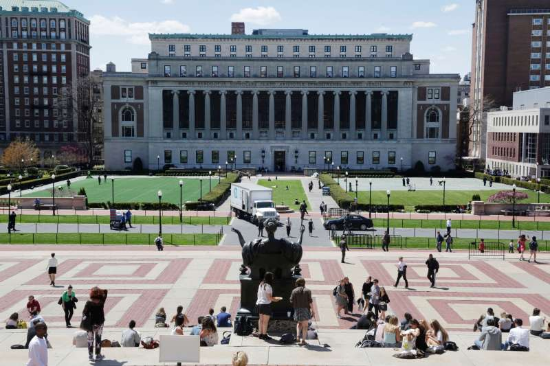 Students sunbathe on the steps of Columbia University's Low Memorial Library, foreground, April 29, 2015 in New York. Butler Library is top center. (AP Photo/Mark Lennihan)