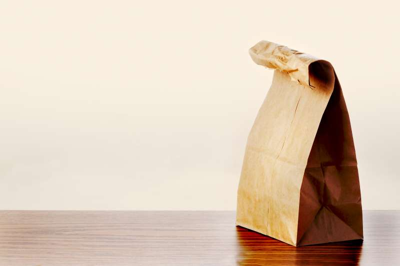 Brown lunch bag on table