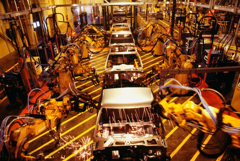 High angle view of robots at work in a plant, GMC Truck Plant, Michigan, USA
