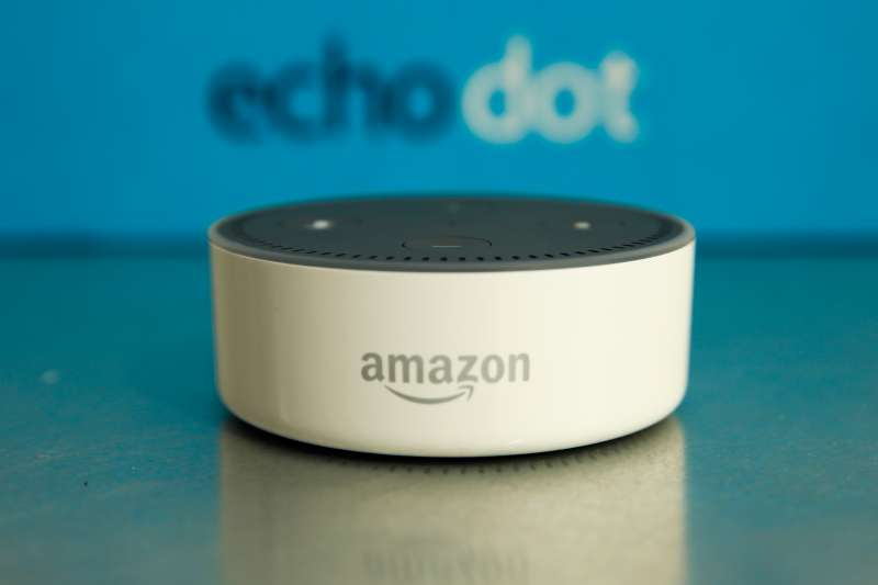 The Amazon  Echo Dot  device sits during the U.K. launch event for the Amazon.com Inc. Echo voice-controlled home assistant speaker in London, U.K., on Wednesday, Sept. 14, 2016.