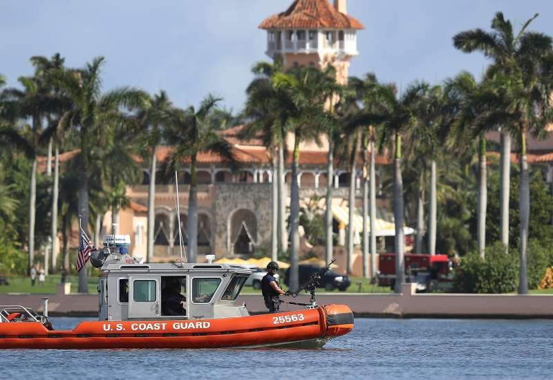 A U.S. Coast Guard boat passes in front of the Mar-a-Lago Resort where President-elect Donald Trump is staying as the 538 members of the Electoral College are set to make his election victory official on December 19, 2016 in Palm Beach, Florida.