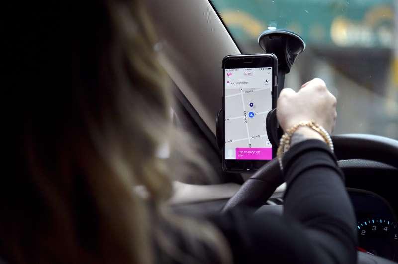 Lyft At Its San Francisco Headquarters Showcasing Lyft Cars, The Glowstache, The Lyft App, Lyft Passengers And Drivers