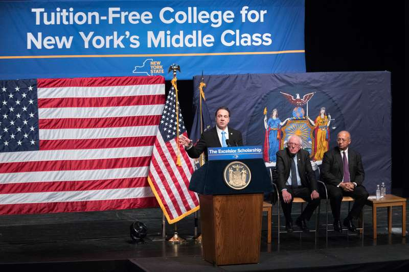 New York Gov. Andrew Cuomo, left, is joined by Vermont Sen. Bernie Sanders, center, and Chairperson of the Board of Trustees of The City University of New York William C. Thompson, as he speaks during an event at LaGuardia Community College, Tuesday, Jan. 3, 2017, in New York. Gov. Cuomo announced a proposal for free tuition at state colleges to hundreds of thousands of low- and middle income residents. Under the governor's plan, which requires legislative approval, any college student accepted to a New York public university or two-year community college is eligible, provided their family earns less than $125,000.