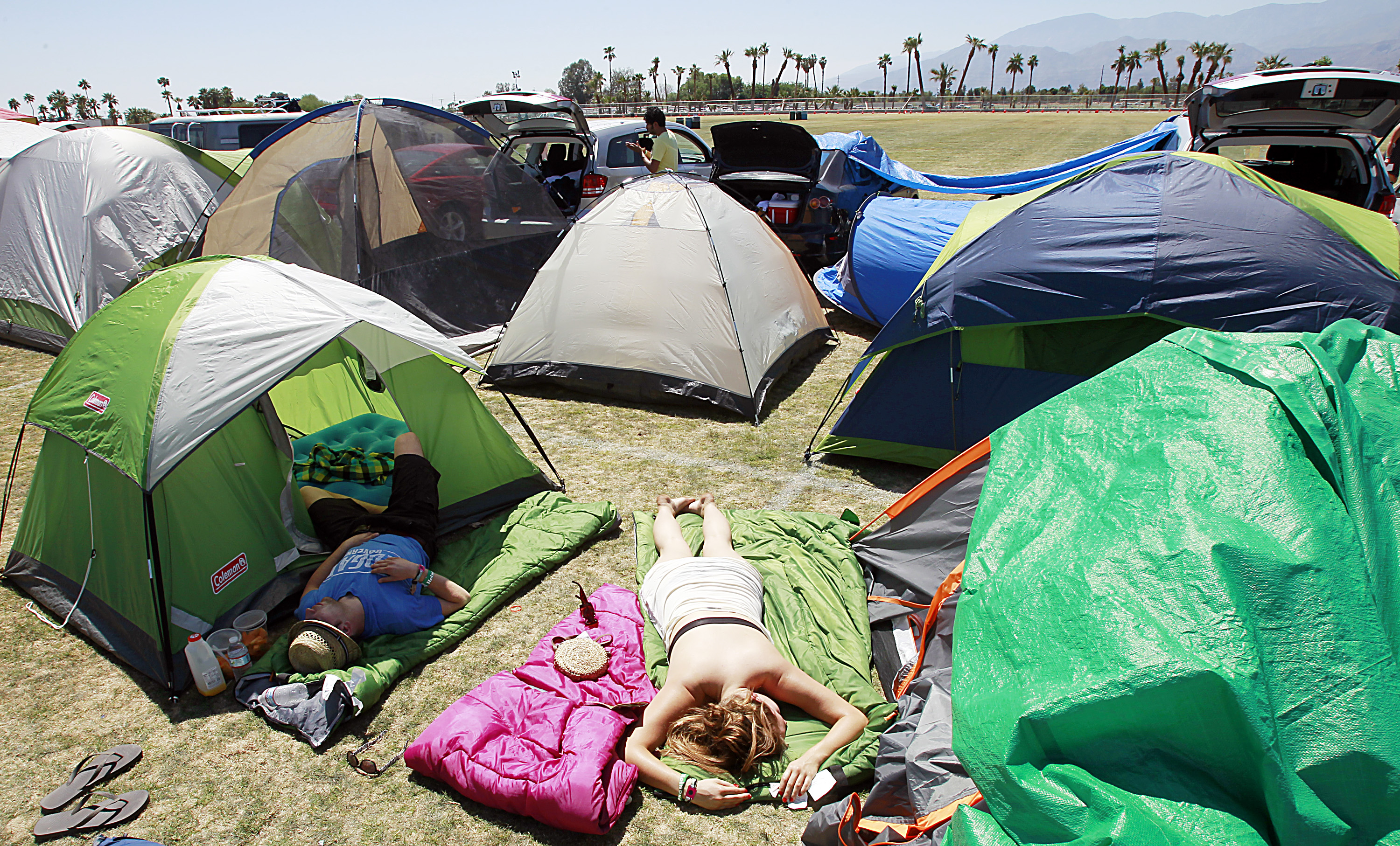 Festivalgoers get some sun and sleep at an onsite campground Sunday, April 17, 2011, at the Coachel