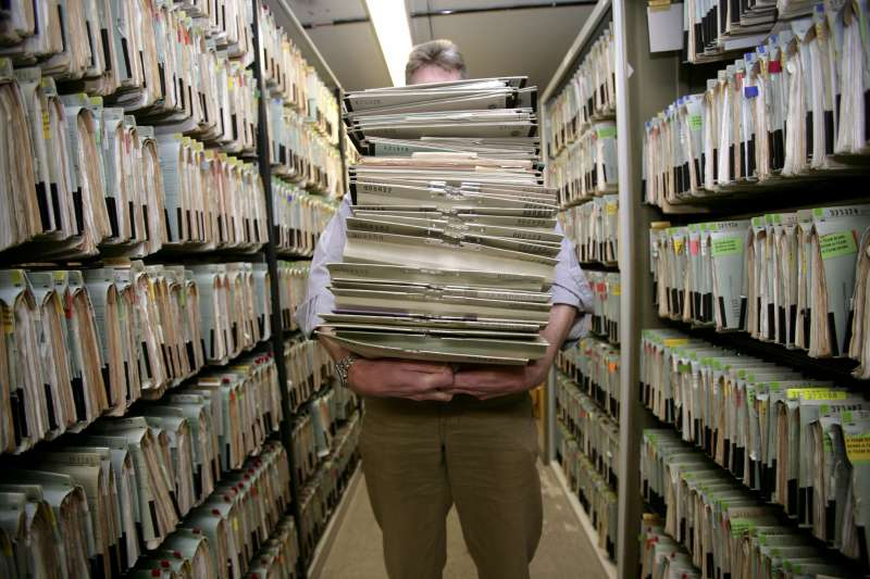 GERMANY, Feature bureaucracy, Our picture shows a man carrying a big mountain of files.