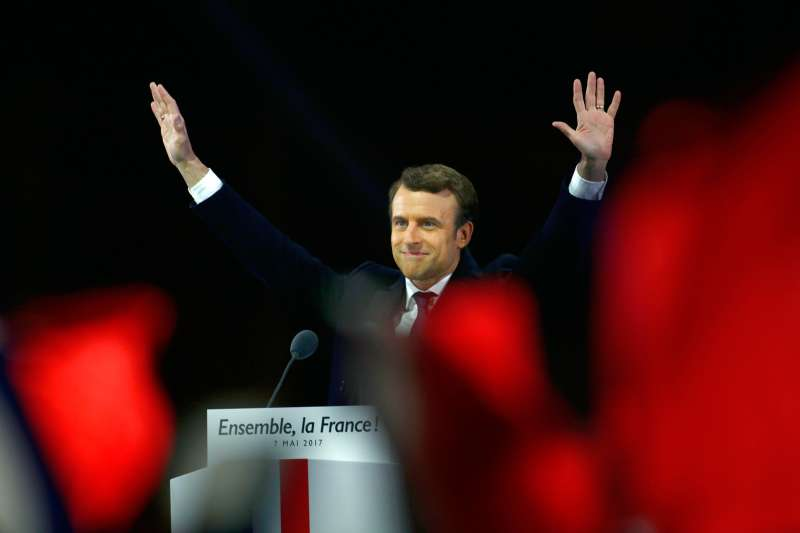 Emmanuel Macron and his wife Brigitte Macron salute voters after his speech as he celebrates his Presidential election victory At Le Louvre In Paris on May 7, 2017 in Paris, France. Emmanuel Macron won the French Presidential election over extreme right candidate Marine Le Pen.