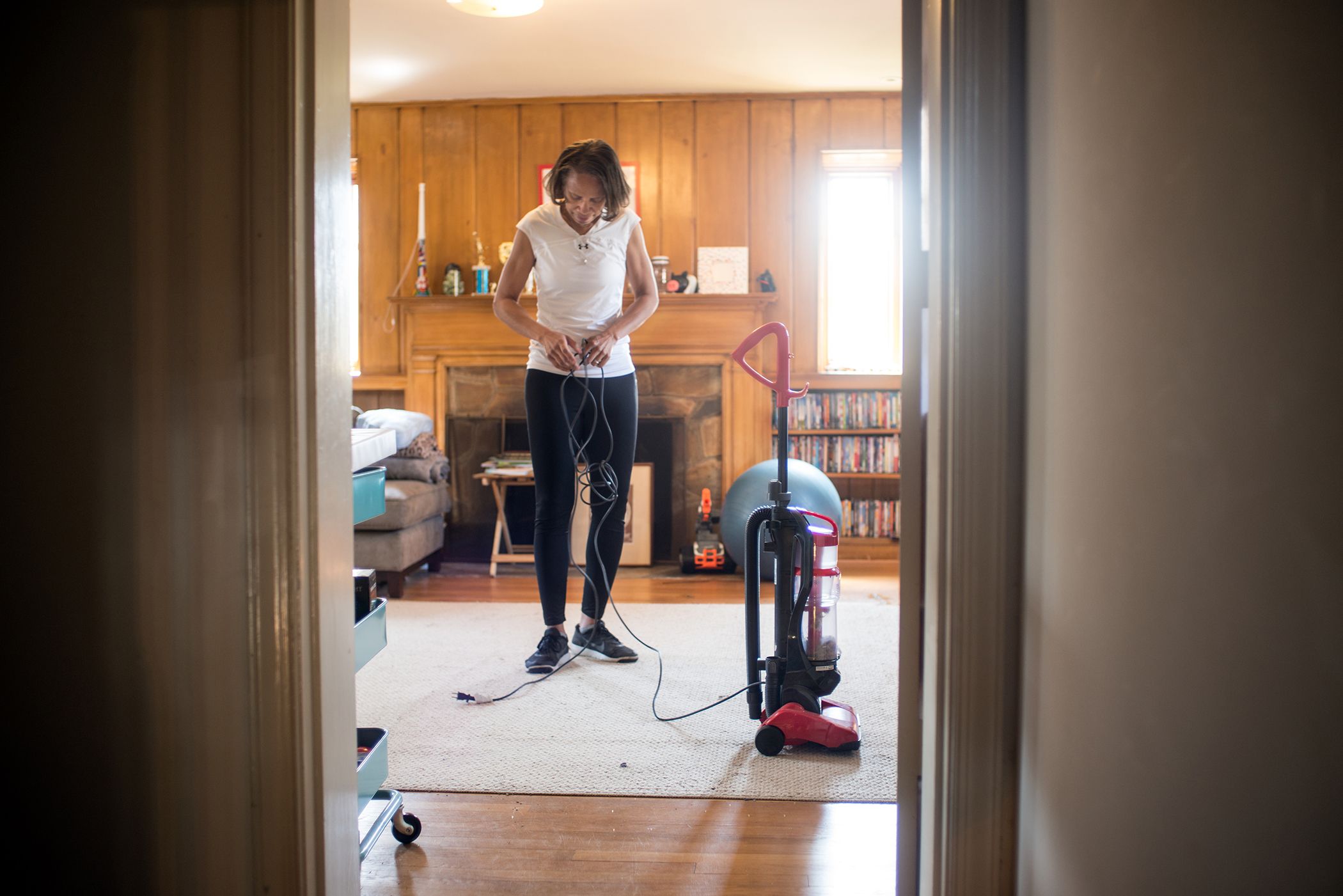 Unemployed lawyer Karen Johnson vacuums her family room while her family is at work and school, April 14, 2017.