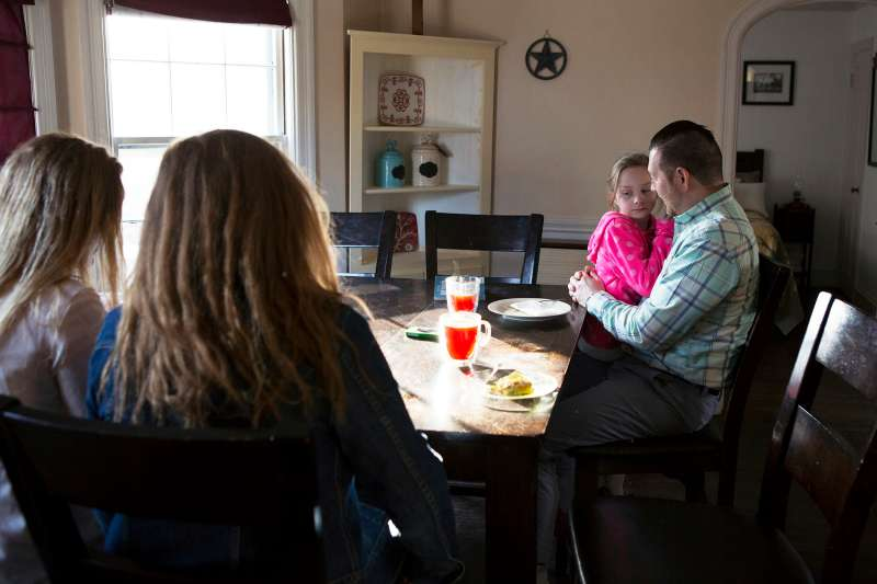 Nathan Bonds spends time at home with his daughters Courtney (15), Sierra (16), and Ava (7) before leaving for work, April 11, 2017.