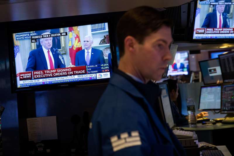 President Donald Trump is displayed on television monitors as traders work and financial professionals work on the floor of the New York Stock Exchange (NYSE) ahead of the closing bell, March 31, 2017 in New York City.