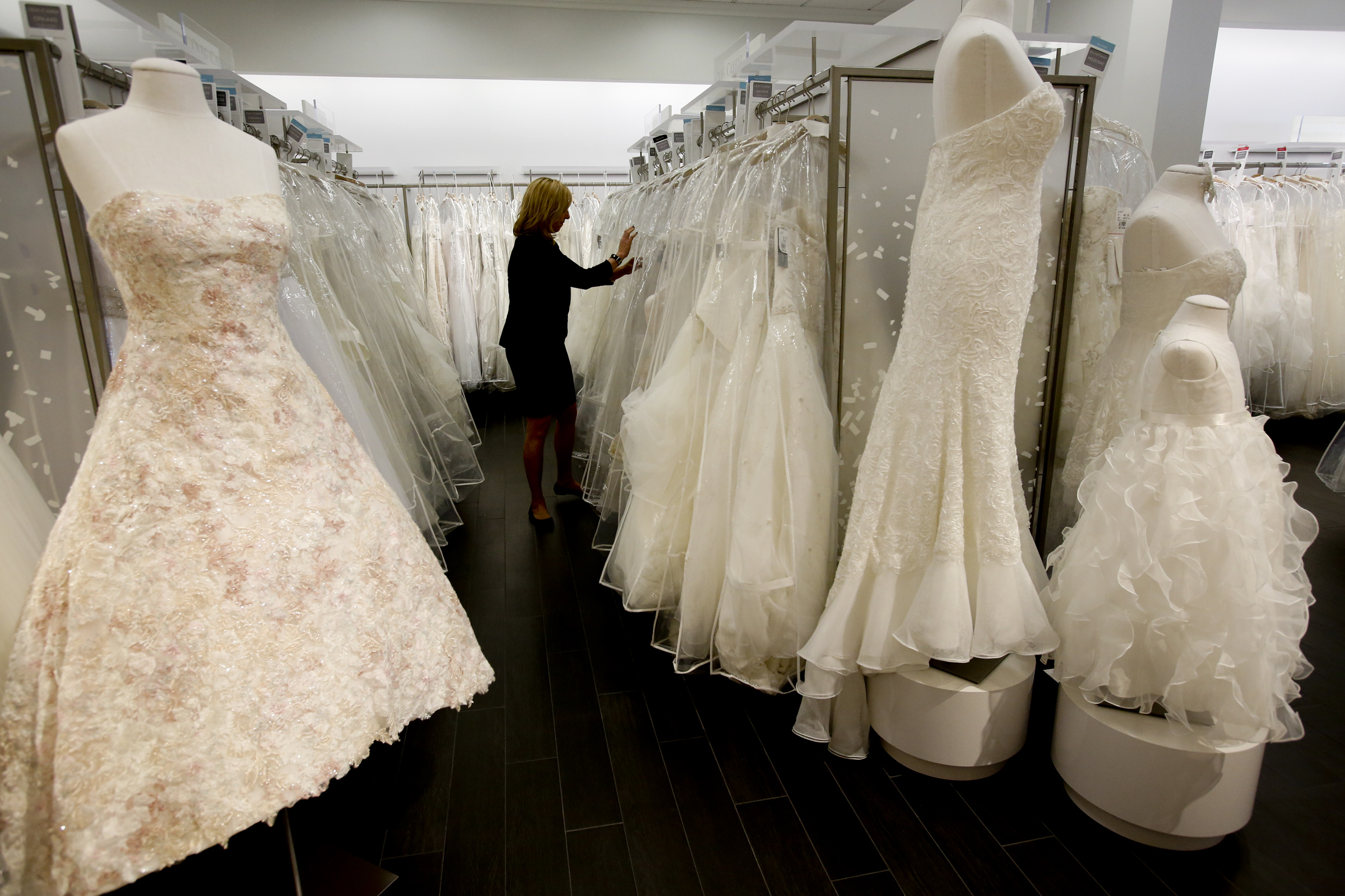 LOS ANGELES, CA. - JANUARY 20, 2014: Store manager Sonni Sanders (CQ) looks for gowns for customers
