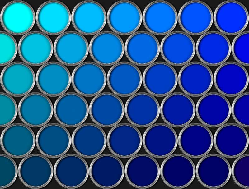 Tins of blue paint in rows on black background