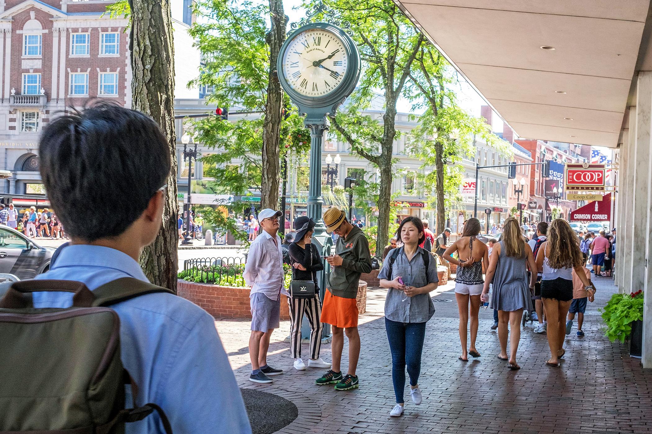 Students walk through Harvard Square, Cambridge, Massachusetts.