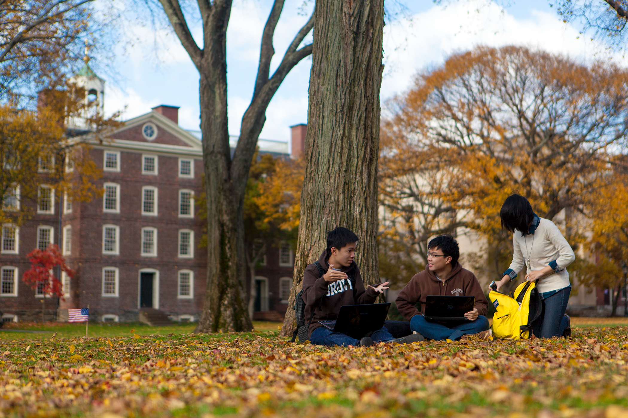 Students on the Quiet Green in autumn