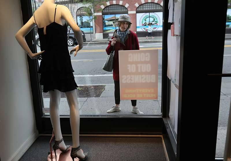 Customers see the business closing signs outside of the Second Time Around consignment shop in Brookline, MA on Jun. 5, 2017. The consignment shops Second Time Around are closing and many customers have not been paid.