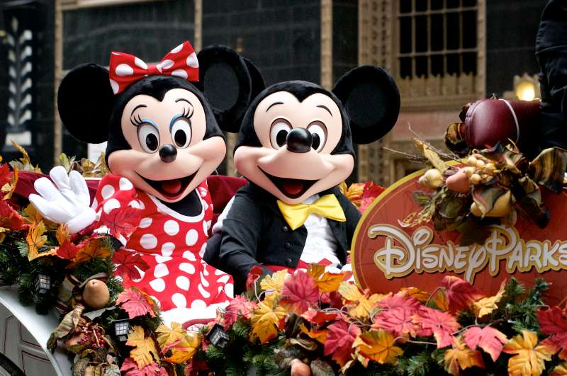 Minnie and Mickey Mouse ride Disney Parks float