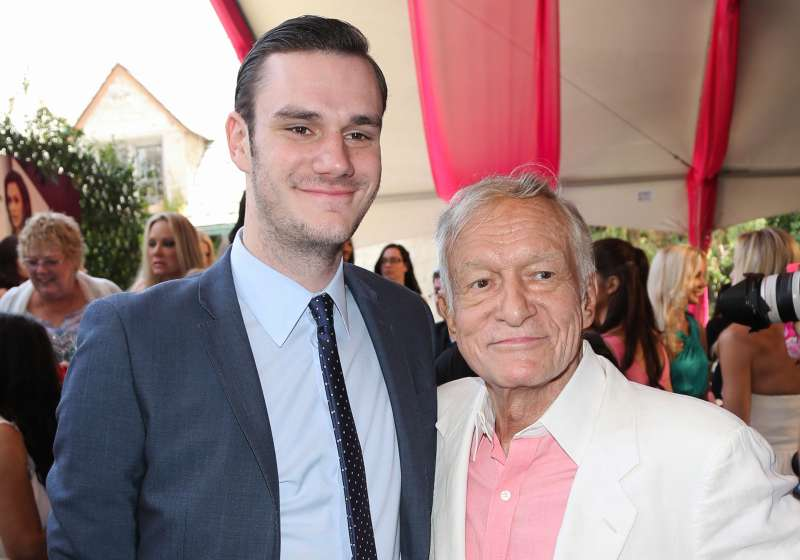 Playboy Founder Hugh Hefner and and his son Cooper Hefner attend Playmate of the Year at the Mansion