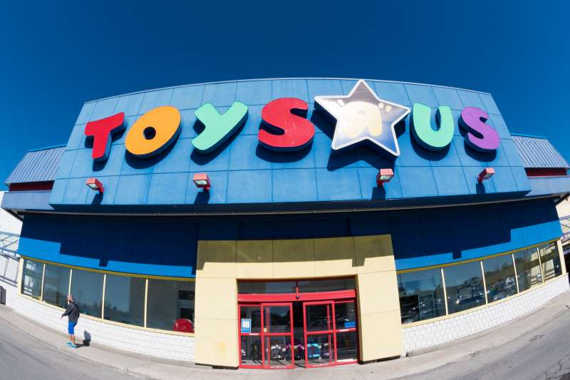 Toys R Us store facade in daytime. Toys  R  Us, Inc. is an