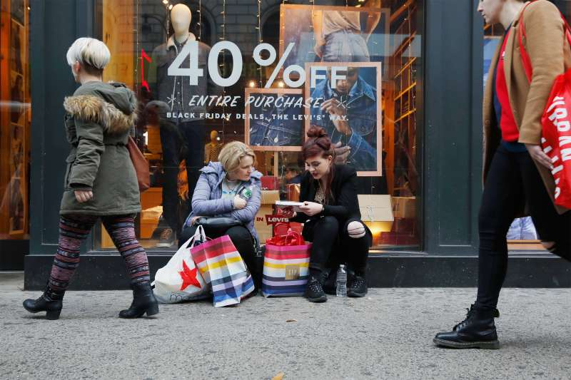 NEW YORK, NY - NOVEMBER 25:  People seen with shopping bags near Herald Square as the Christmas shopping season kicks off on November 25, 2017 in New York City.