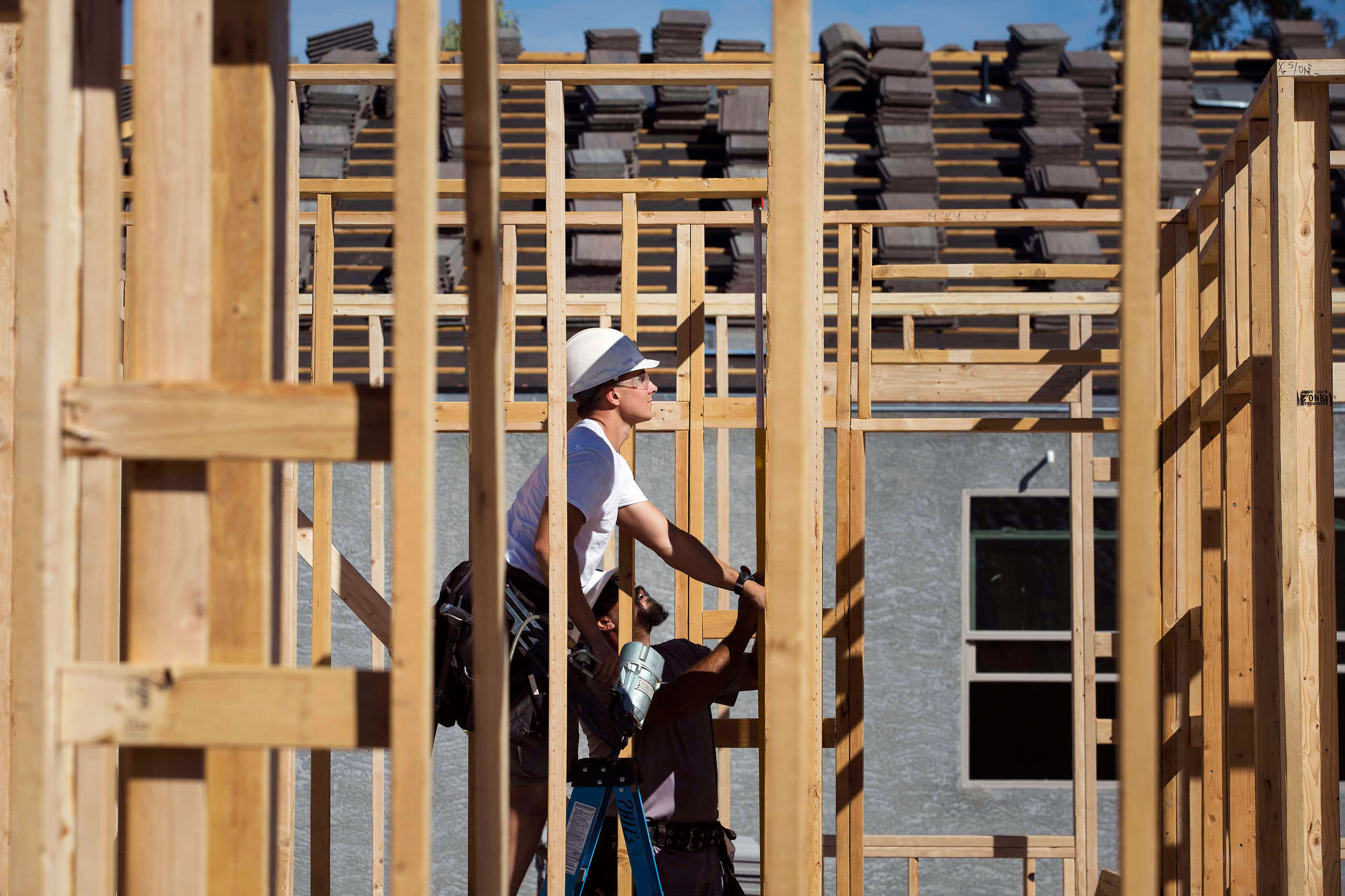 Contractors work on the frame of a home under construction at the D.R. Horton Express Homes Magma Ranch development in Florence, Ariz.