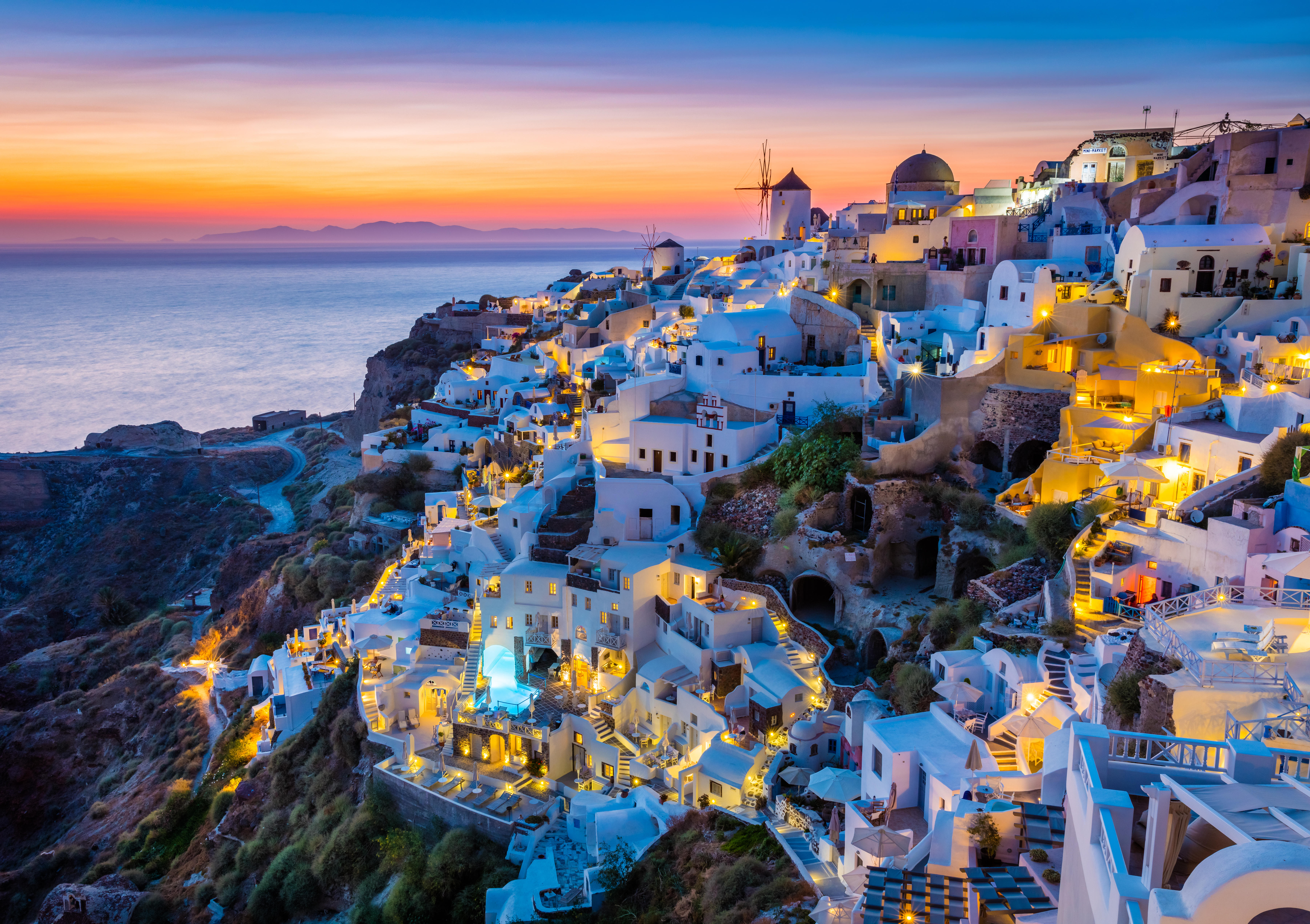 Iconic sunset in the town of Oia on the greek island Santorini (Thera).