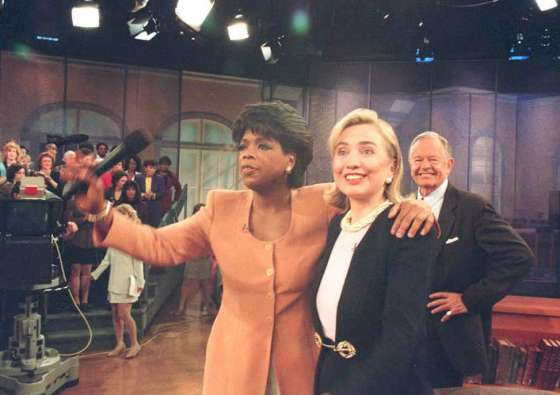 US First Lady Hillary Clinton (R) stands with tele
