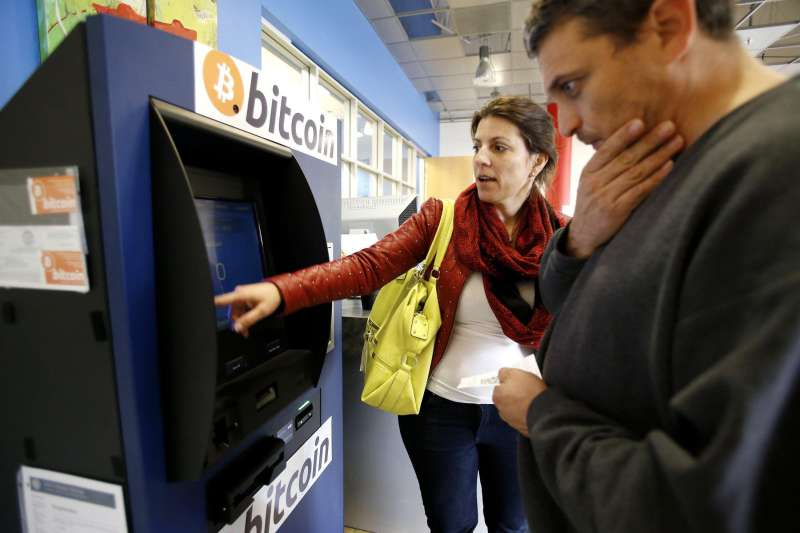 Hami Oerner and Itzik Lerner, right, learn how to use a new bitcoin ATM machine at Hacker Dojo in Mountain View, Calif., April 1, 2014. Robocoin is California's first permanent 24/7 bitcoin ATM machine. (Gary Reyes/Bay Area News Group/MCT)