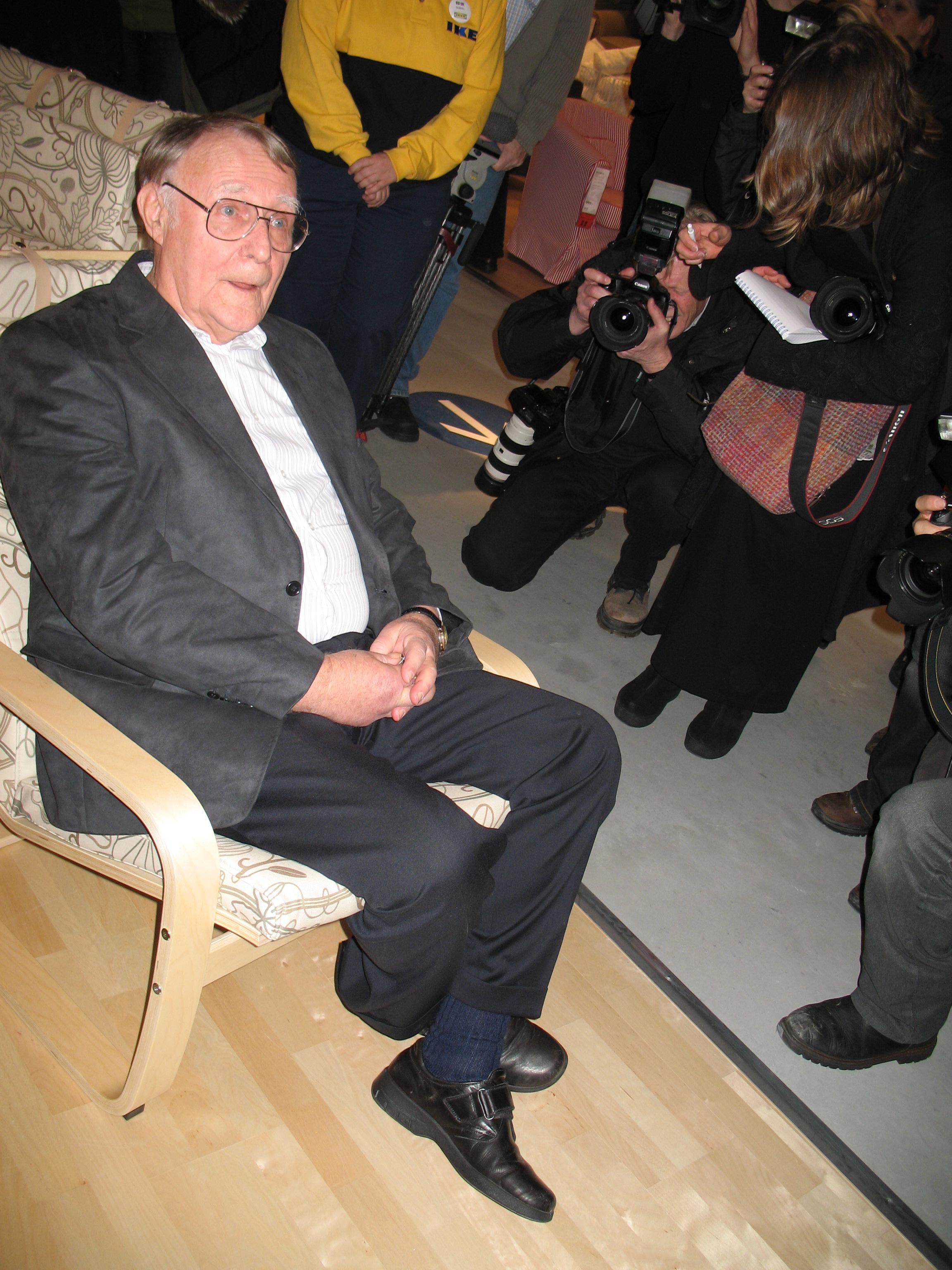 Ingvar Kamprad, founder and chairman of IKEA tries an armcha
