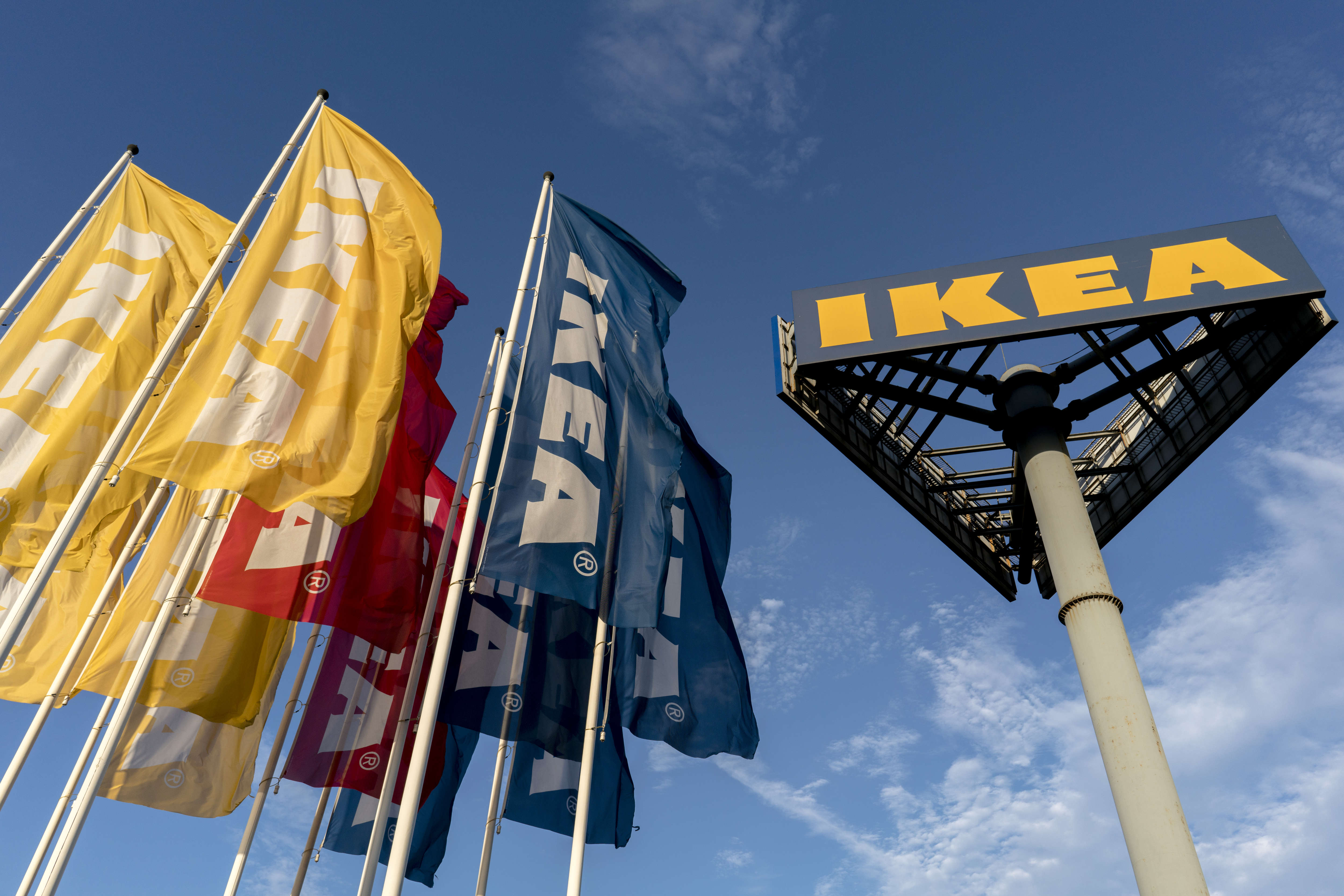 Colorful flags of IKEA flying in the sky. A financial