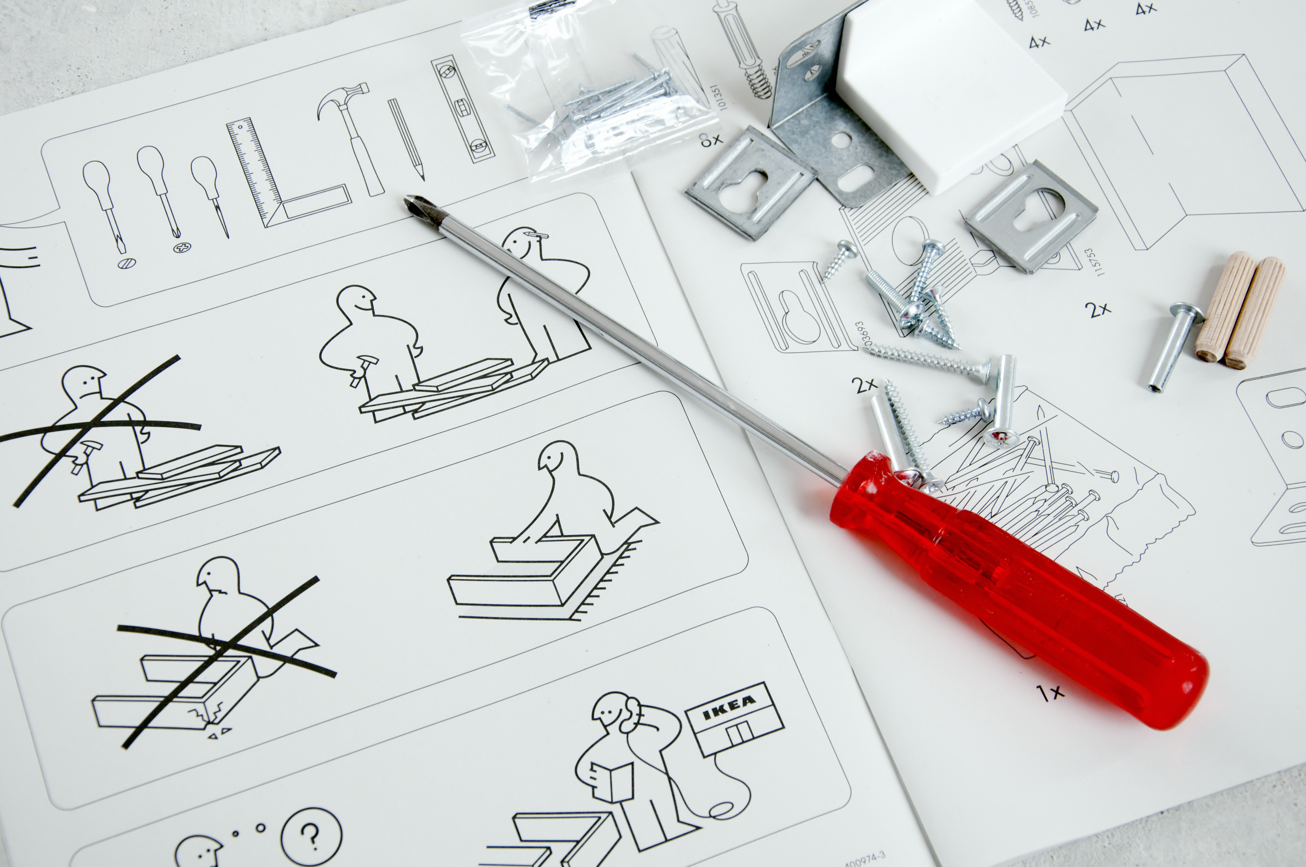 IKEA instruction manual with screwdriver and screws