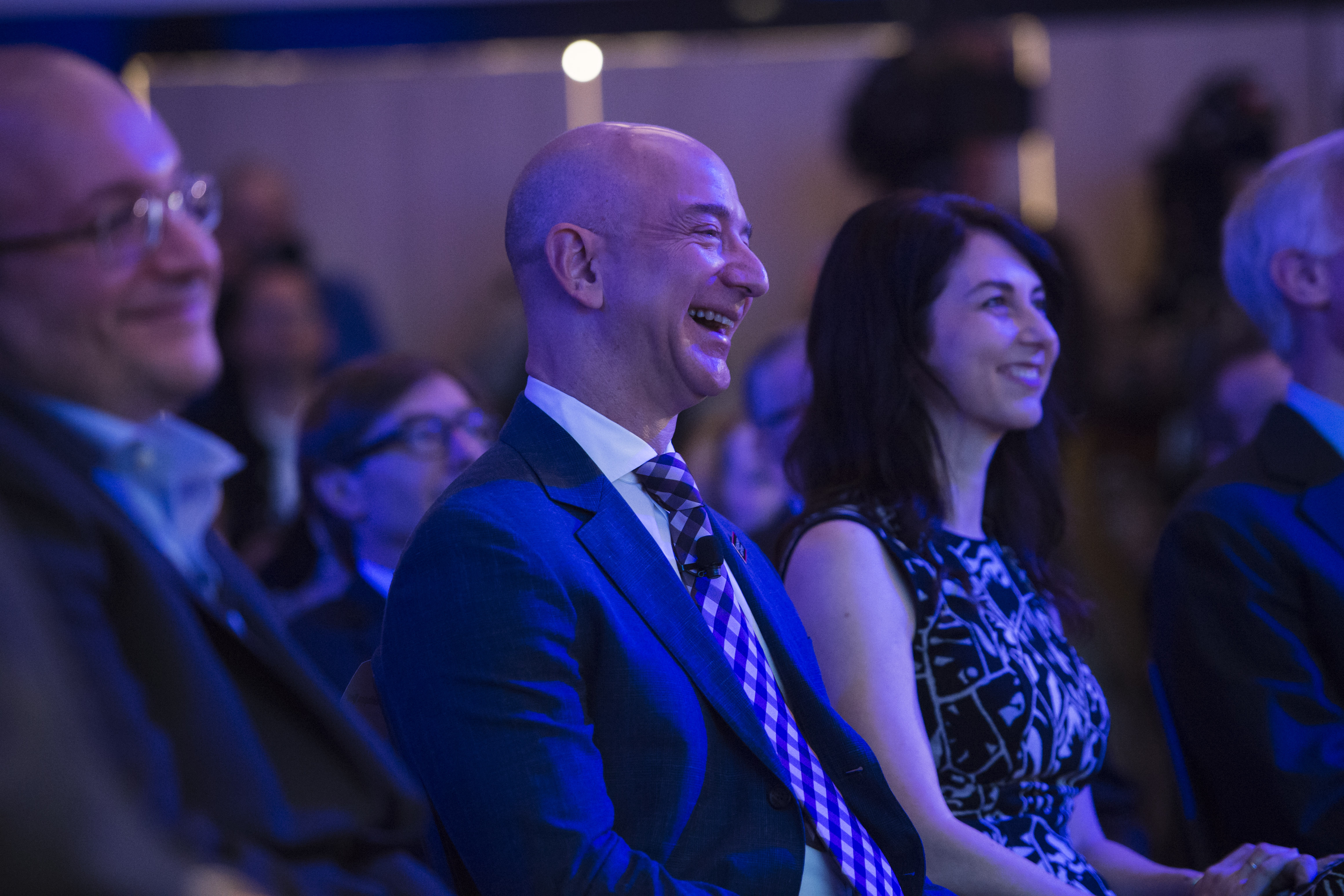 Freed Washington Post reporter Jason Rezaian, Secretary of State John Kerry, and Amazon founder and Washington Post owner Jeff Bezos during an opening ceremony for the new headquarters of The Washington Post.