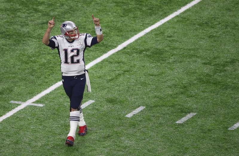 Tom Brady on a football field