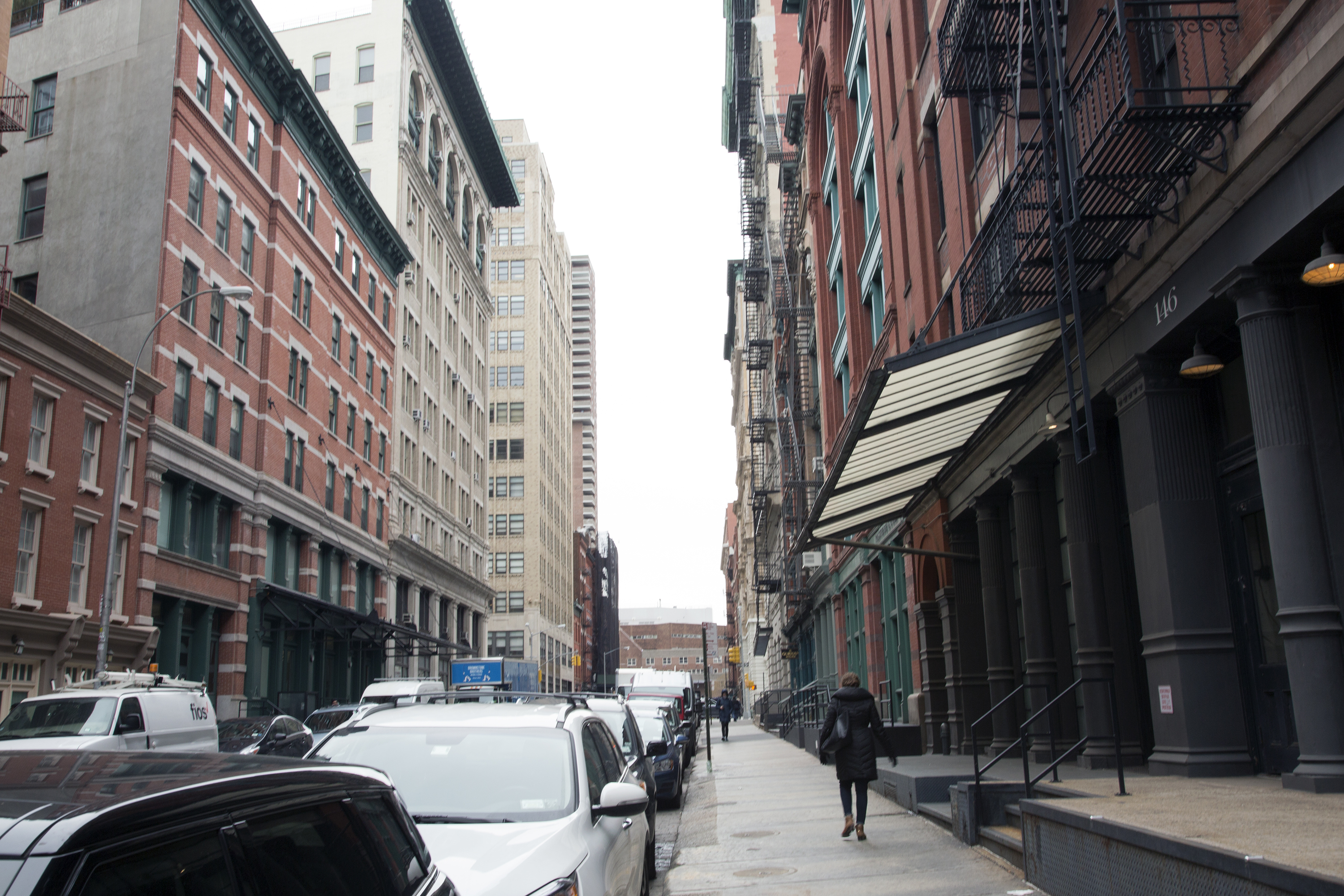 Passerby on Franklin Street paid little mind to the superstar's residences, pictured on the left side of the street, Tuesday morning.