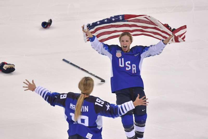 Team USA women's hockey team celebrating gold